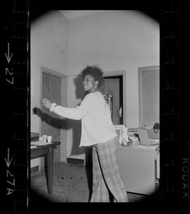 Rebellious Black student at Brandeis enjoys some mod dancing while she awaits Pres. Abram's next move