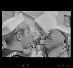 """An amazed Gerald LeMar, after embracing his wife, turns to his daughter, Janet, 9 months, and says, """"Honey how you've grown."""" Then the veteran from Vietnam lifts her high for closer look"""