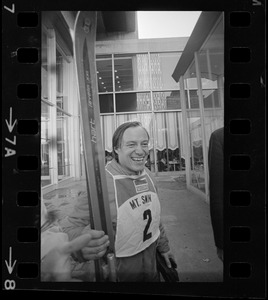 Ruedi Wyrsch after rappelling down the side of the Sheraton Boston wearing skis