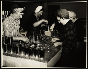 Inspection of meats before weighing and packing. Last step will be sterilizing for 25 minutes at 240 degrees in a retort which processes 1200 cans each run. Left to right, Thelma Hall, Hazel Robbins, Bertha Heyward and lena Mitchell.