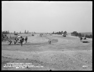Distribution Department, Southern High Service Forbes Hill Reservoir, building the north bank, watering and rolling, Quincy, Mass., Sep. 1, 1900