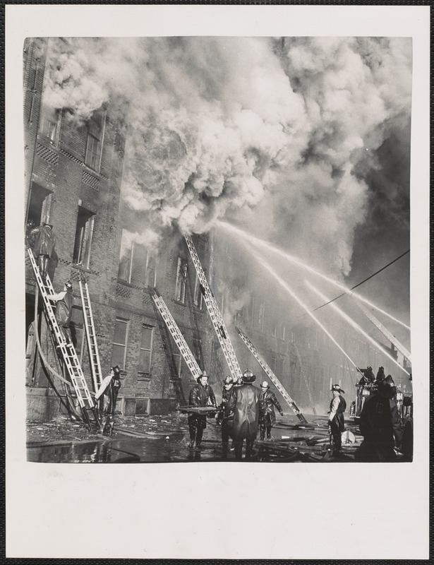 Billows of smoke pour from the John P. Squire Co. meat packing plant, as fireman battle to bring the blaze under control