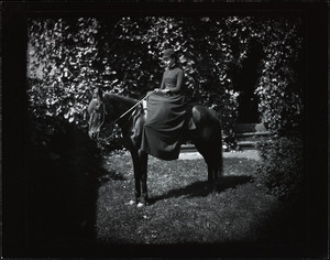 Young woman on a small black horse
