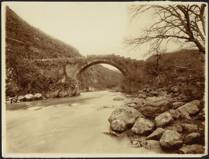 Arched keystone bridge over river