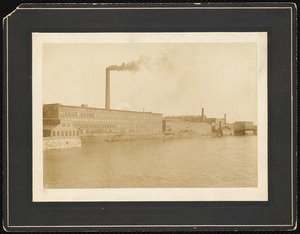 View of a mill across a river