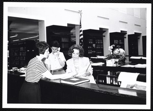 Newton Free Library, Newton, MA. PR pictures. Beth Purcell, Elinor H., at reference desk