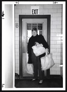Newton Free Library, Newton, MA. PR pictures. Wilma Kassakian, volunteer delivering books