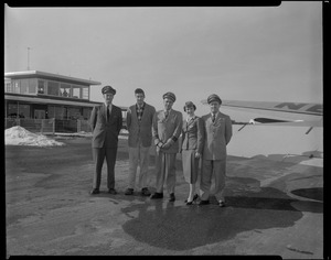 Airport scene, group of four men and a woman