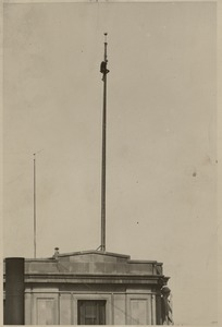 Boston City Hall - man on flagpole