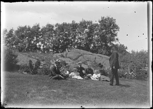 Charles W. Parker (standing) with others seated on the ground, Marblehead, MA