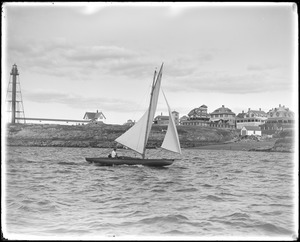 Boat sailing into Marblehead Harbor past Marblehead light tower