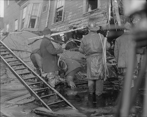 Firemen standing in thick molasses after the disaster