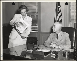 Brig. Gen. Detrick and woman with papers