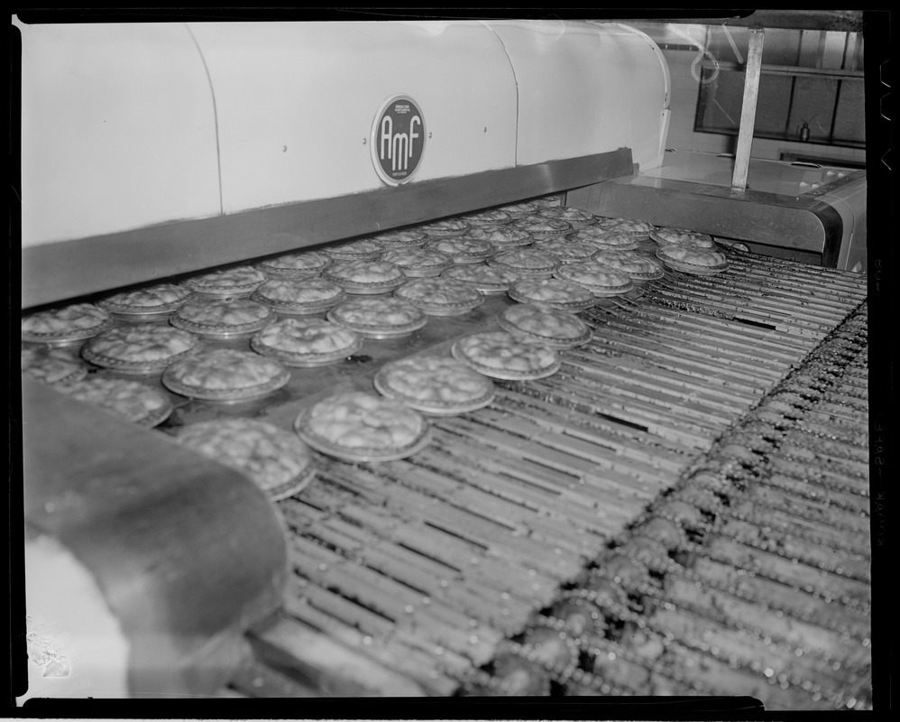 """10"""" pies coming out of oven, Table Talk factory in Worcester"""