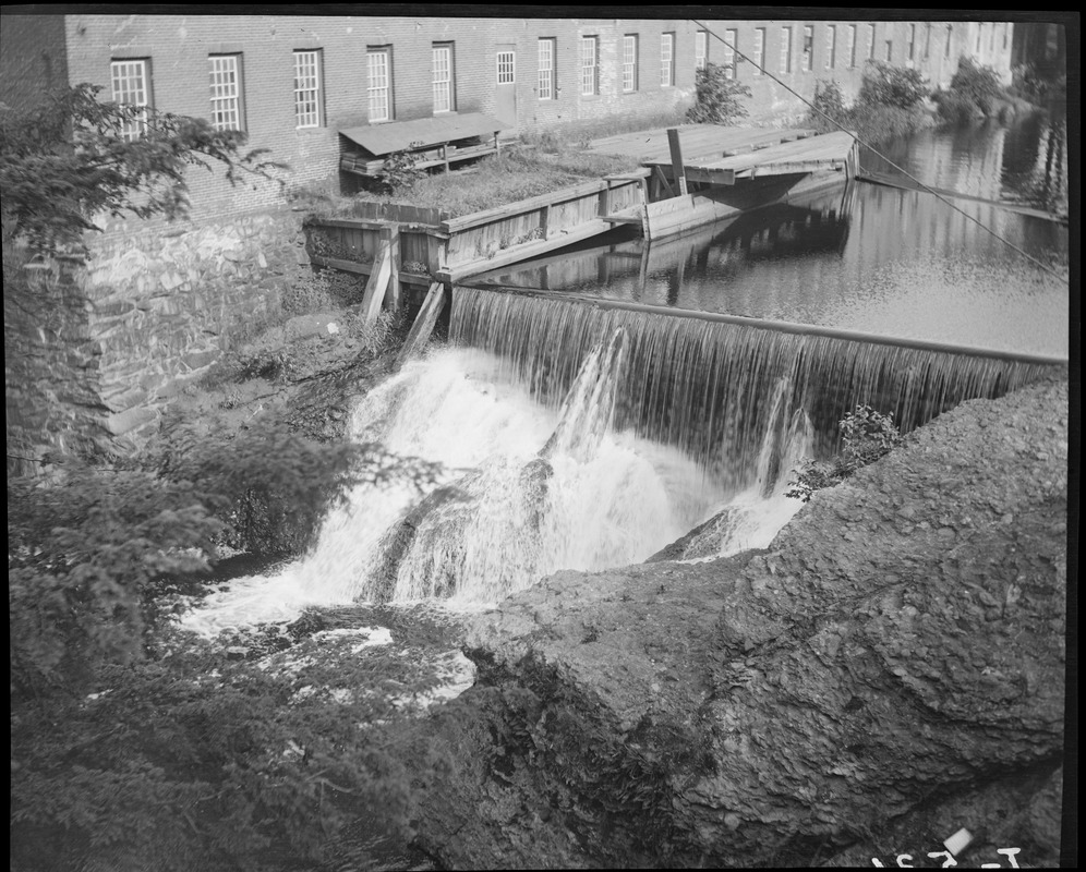 Waterfall next to mill building