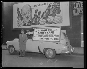 Auto advertising the Handy Café and Sandy MacNair and his band