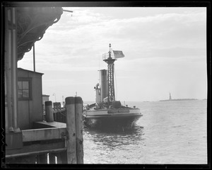 """Engine Co. 57 Fireboat """"Thomas Willet"""" of New York. Fireman is Al Derby."""