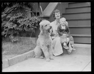 Woman, child and poodle