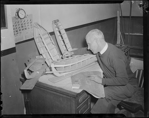 Man making model boat, Boston School Dept.