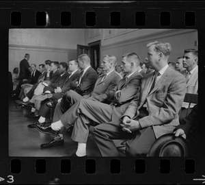 A group of men, most likely new police officers, sitting in a Boston Municipal Courtroom while Judge Adlow presides over a session