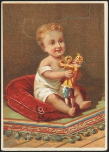 Child playing with a doll.