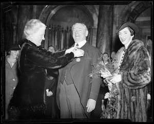 Receiving the Medal of Peace with daughter Mary looking on