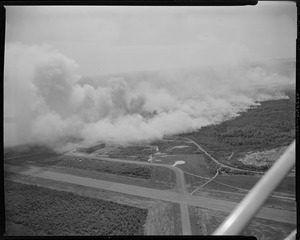 Aerial photo of forest fire near airport