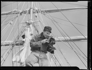 Man in rigging with camera