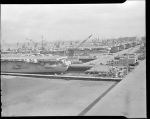 Uncle Sam's aeroplane carrier tied up at South Boston Navy Yard - from Commonwealth Ice & Cold Storage building
