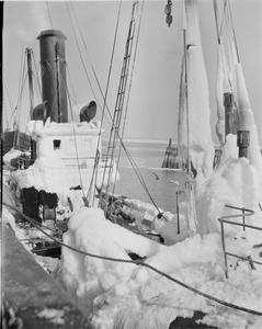 "Ice covered ships in harbor - ""Covena"""