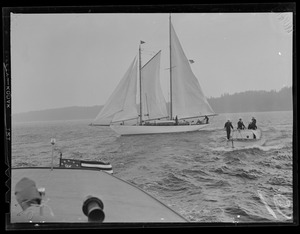 Sail boat and sailors in launch