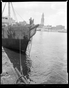 "Old sailing ship docked at Fan Pier, making ready to be towed out of Boston Harbor by the ""Vagabond Prince"""