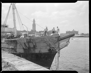 """Old sailing ship docked at Fan Pier, making ready to be towed out of Boston Harbor by the """"Vagabond Prince"""""""