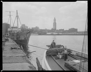 """The """"Vagabond Prince"""" and her tow, tied up to Fan Pier"""