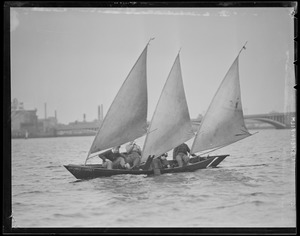 "College students sail strange three-masted boat ""Gov. Charles F. Hurley"" on Charles River"