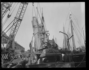 """New engine going aboard trawler """"Atlantic"""" at fish pier, South Boston"""