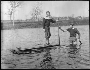 Boys with homemade raft