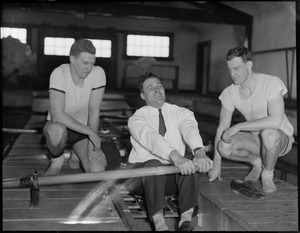 Crew coach Charlie Whiteside plies an oar while two Harvard champs, Gridley Barrows, wrestling, left and Bradford Simmons, boxing, look on.