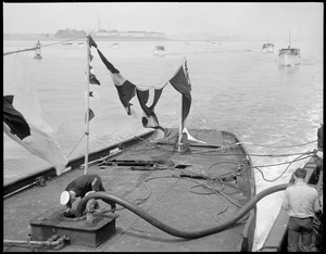 Cup defender Mischief at East Boston being prepared for burial at sea at Graves Light
