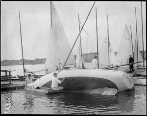 Cleaning his hull - Winthrop Yacht Club