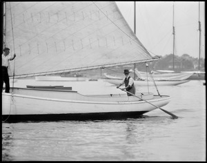 Yachting off Marblehead, 87 year old Marblehead skipper, Capt. Von Caswell with his 50 year old sloop - Gypsy
