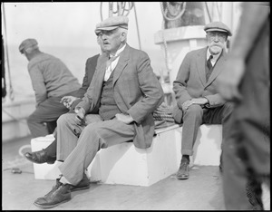 Capt. Blackburn and Capt. Louis Thebaud aboard the fishing schooner Gertrude L. Thebaud in Gloucester. Blackburn sailed a dory across wintry ocean, freezing his hands and feet badly.