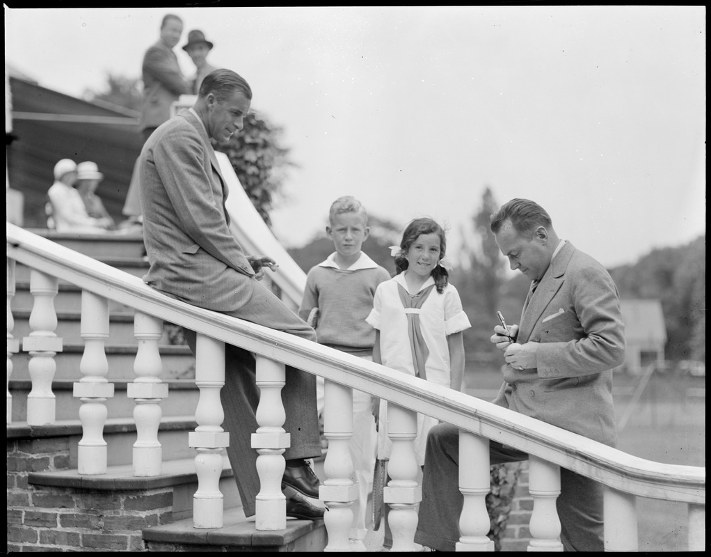 Bill Tilden and Francis Hunter signing tennis balls for young