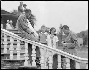 Bill Tilden and Francis Hunter signing tennis balls for young players, Longwood Court