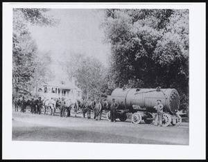 At foot of Church Hill, steam boiler for Aspinwall Hotel pulled by team of 10 horses