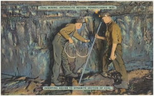 Coal mining, Anthracite Region, Pennsylvania. Inserting squibb to dynamite section of coal
