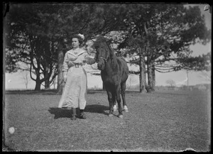 Young lady with saddle horse