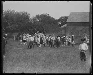 Group at Ag. Hall, WT. Children playing ball (Raymond's house in background)