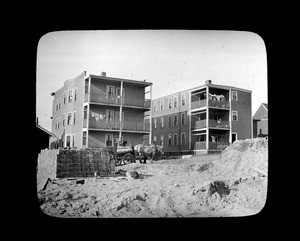 Two-three apartment houses, built from materials obtained from Old Quincy School