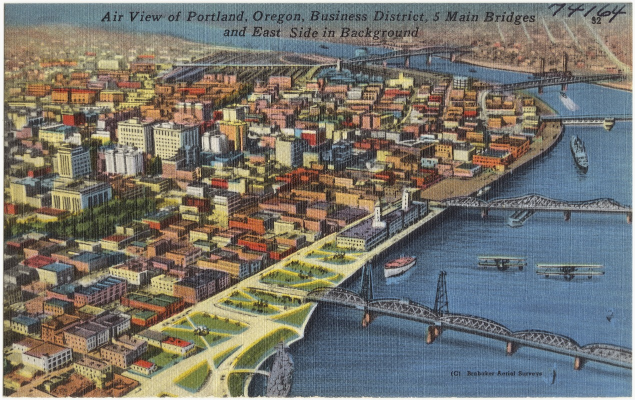 Air view of Portland, Oregon, Business District, 5 main bridges and east side in background